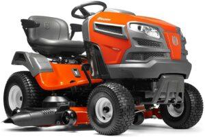 在车库或棚子中占用的存储空间更少的坐骑式除草机 Husqvarna YTA24V48 24V Fast Continuously Variable Transmission Pedal Tractor Mower